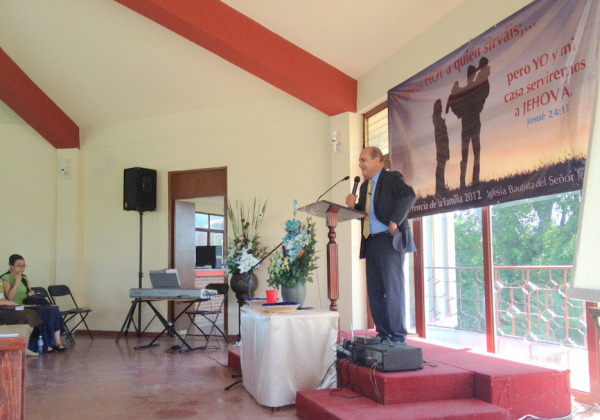 Pastor Luis Ramos preaching in Cuatla Morelos at a Family Conference