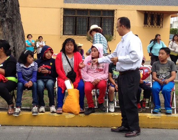 Giving out 20,000 tracts during the Cinco de Mayo Parade in Puebla