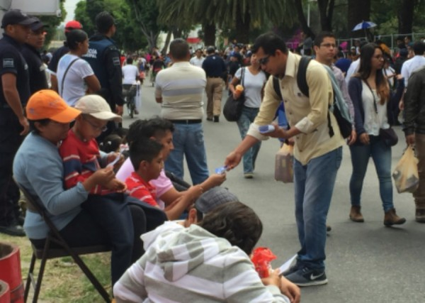 "Giving 20,000 tracts during the ""5 de Mayo"" Parade here in Puebla"